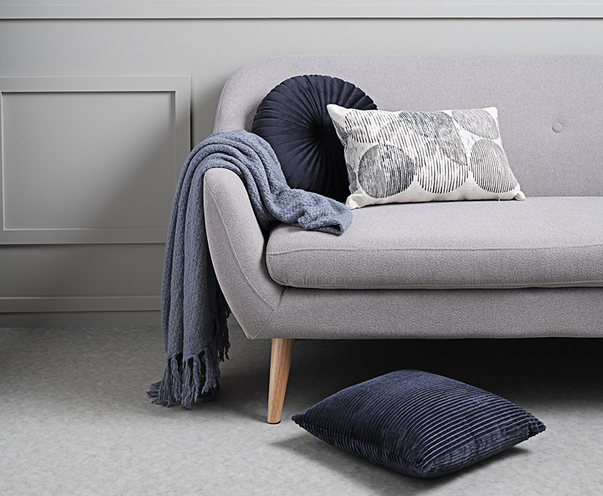 Sofa with throw and sofa cushions