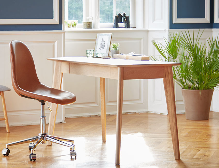 Oak desk and leather office chair in a classy room