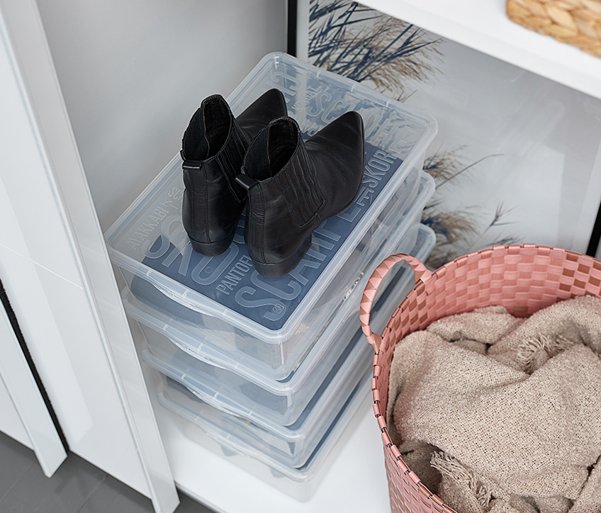 Wardrobe interiors with shelves and shoe organisers in a stack
